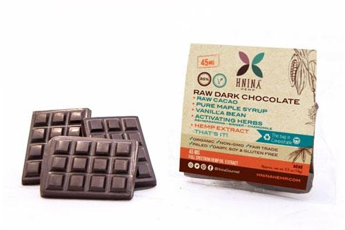 HNINA dark chocolate bars contain raw cacao, pure maple syrup, vanila bean, activating herbs, and hemp extract