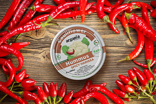 Argania Foods' cauliflower hummus product can be strategically merchandised with fresh veggies, salsa, pita chips, and on cheese shelves