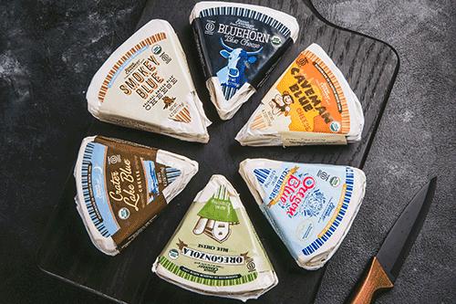 Rogue Creamery has debuted its line of pre-packaged blue cheese wedges, featuring six organic, cave-aged varieties