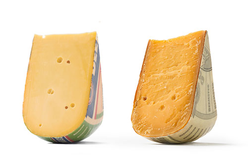 A mild Beemster cheese wedge, aged two months (left), and an XO cheese wedge, aged 26 months (right)