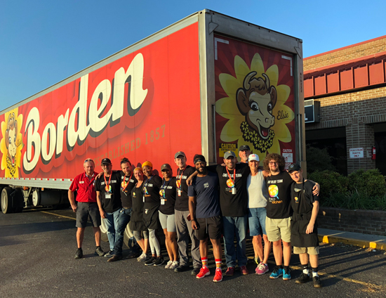 Borden Dairy employees stand in front of a freight truck used to deliver milk to needy recipients in the wake of Hurricane Florence