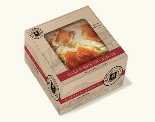 Pre-cooked, the 10.5 oz Baked Brie en Croute is flow-wrapped, safely sealing the product, then placed in a pastry shop-style box with a window, delivering visual appeal for impulse sales in the deli or prepared foods sections