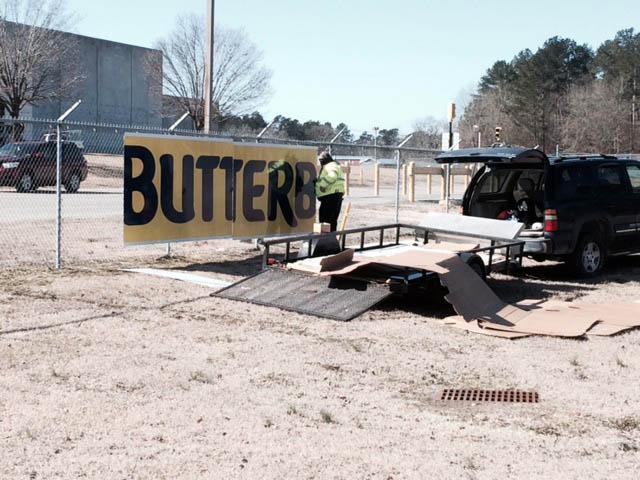 Hanging up the sign at the new Butterball plant. Photo credited to Gilbert Baez and WRAL.com.