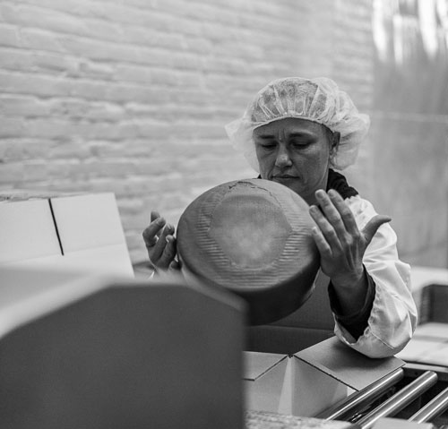 Cheesemaker packaging artisan cheeses