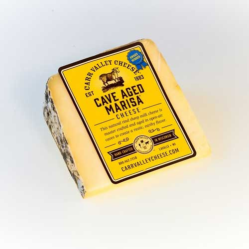 "Carr Valley was awarded ""Super Gold"" for its Cave Aged Marisa®, an artisan cheese made with local sheep milk, which is then carefully cave-aged for a complex and earthy flavor"
