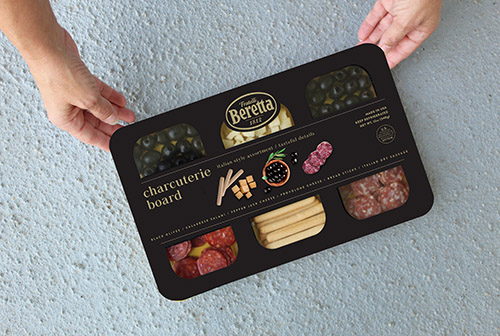 Fratelli Beretta's Italian style charcuterie board is composed of Italian dry sausage, Calabrese salami, black olives, pepper jack and provolone cheese, and breadsticks