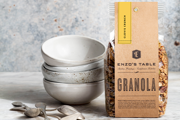 ENZO'S TABLE and ENZO Olive Oil are rocking the snack aisle as they roll out a brand-new granola, Clovis Crunch
