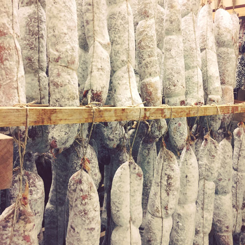 Hanging Gentile Giant Salumi products