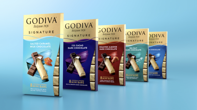 GODIVA is revealing its strategic prowess with the launch of its Signature Mini Chocolate Bars as it takes a bigger bite out of the $18 billion premium chocolate sector