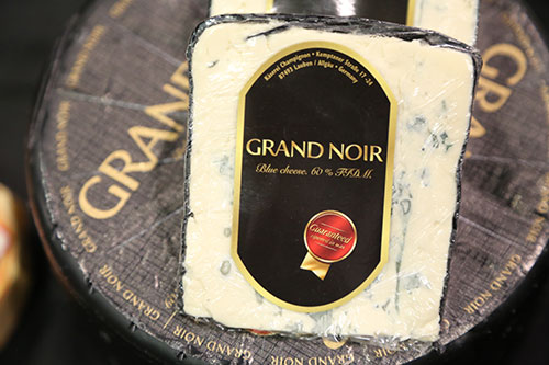 The Grand Noir holds the 2016 title of Best In Class at the World Championship Cheese Contest—a major point of pride for Champignon