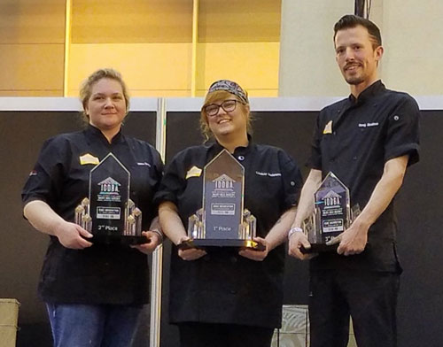 Winners of the Cake Decorating Challenge at IDDBA 2018. From left to right: 1st place, Lindsay Anderson; 2nd place, Natasha Damm; 3rd place, Randy Stratton