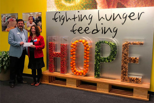 Exhibiting companies shared a lot more than good times at this year's expo with a donation of 176,315 pounds of food