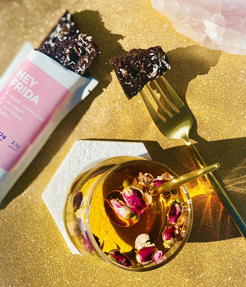 Hey Frida offers aDark Chocolate + Coconut + Collagen flavor(the Beauty Bar), with aDouble Chocolate + Mint + L-Theanine flavor(dubbed The Relax Bar) debuting this month