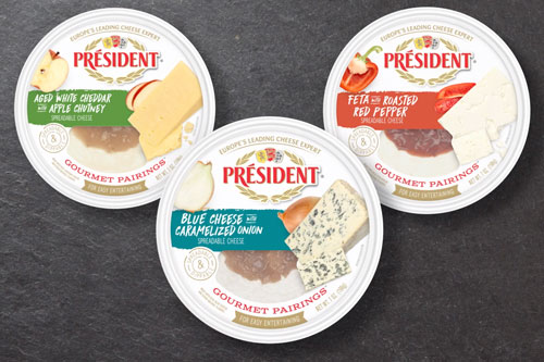 The new line includes three different flavors: aged white cheddar with apple chutney, feta with roasted red pepper, and blue cheese with caramelized onions