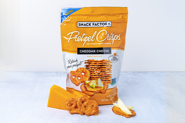 Pretzel Crisps has announced the launch for its newest flavor variety: Cheddar Cheese