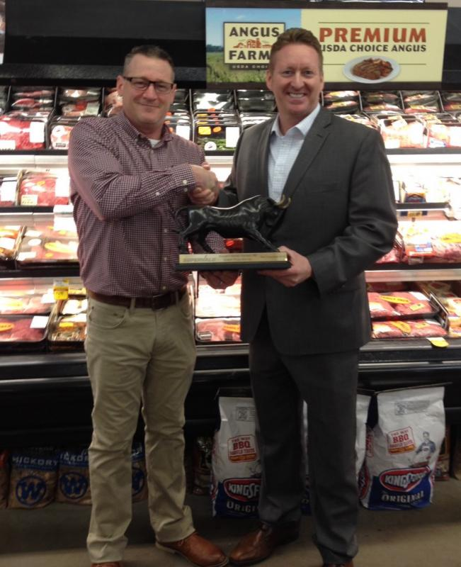 Roy McKenzie of Krause's Market and Tony Ott of UNFI shaking hands over the success of the meat stampede