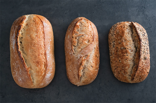 Silverton and Davis spent months experimenting with recipes and ingredients before finalizing the three breads that will be on shelves and available at the La Brea Bakery Café later this month