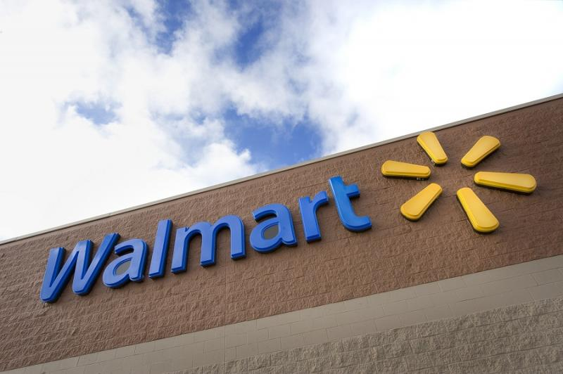 Wal-Mart shares rise despite 3Q earnings plunge