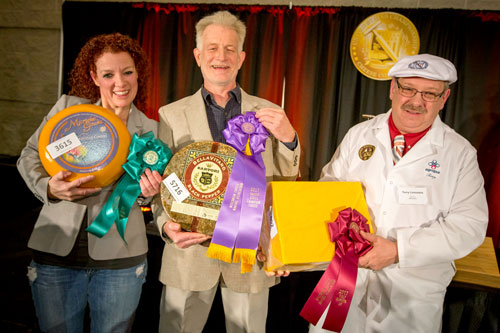 The top three U.S. Championship Cheese Contest winners. Pictured (left to right): Marieke Penterman of Marieke Gouda in Thorp, Wisconsin, with her USCCC Second Runner-Up Marieke Gouda Belegen; Mike Matucheski of Sartori Cheese in Antigo, Wisconsin with his Grand Champion Sartori Reserve Black Pepper BellaVitano, and Terry Lensmire of Agropur in Weyauwega, Wisconsin with his First Runner-Up Cheddar, Aged One to Two Years, at the Cheese Champion Reception in Green Bay, Wisconsin on Thursday, March 9, 2017.