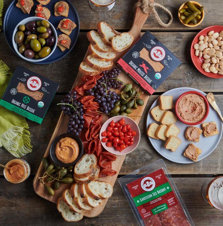 Les Trois Petits Cochons' Basque line features an Organic Pâté Basque, Organic Mousse Basque, Saucisson Sec Basque, Basque Sausage, and the newly launched Moutarde Basque